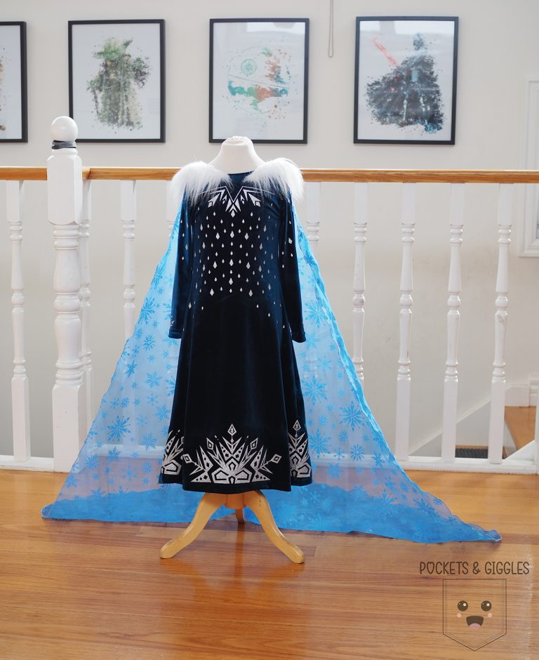 The front of an Elsa dress, placed on a child size mannequin.